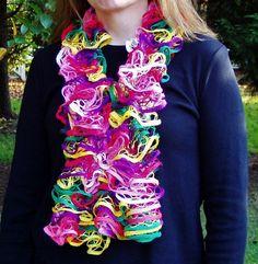 Hand knitted ruffle scarf in bright orange, green, yellow, purple, white and rose pink #handmade #design