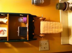 Powder room towel bar from a vintage spool.