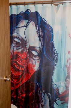 aparently my bf wants this shower curtain... imagine walking into the bathroom to see this! im already scared of zombies lol