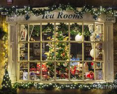 Broadway tea room christmas tree shop display window at night Christmas Puzzle, Christmas Poster, Christmas Store, Christmas Scenes, Christmas Mood, Noel Christmas, Christmas Pictures, Vintage Christmas, Christmas Windows