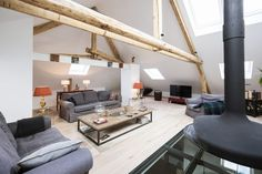 Attic Apartment in Luxembourg Combines Modern and Rustic Details - http://freshome.com/attic-apartment-Luxembourg/