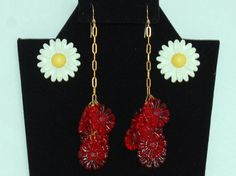 Cool 70's hippie woodland daisy earrings, 2 pairs boho fabulous flowers: metal & enamel yellow center studs, red lucite gold plate dangles by BetseysBeauties on Etsy