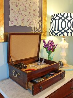 The upcycling and repurposing experts at HGTV.com share step-by-step instructions for refinishing and re-lining an old cutlery box to turn it into a pretty new jewelry box.