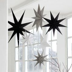 White Cardboard Hanging 9 point Stars to hang alone or in clusters. Lovely Scandinavian Christmas Decorations from House Doctor at Design Vintage. Minimal Christmas, Black Christmas, Modern Christmas, Scandinavian Christmas, Christmas Star Decorations, Diy Christmas Tree, Tree Decorations, Christmas Stars, Christmas Dining Table
