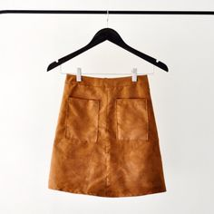 Get trendy by sewing your own version of the increasingly popular tan suede skirt.
