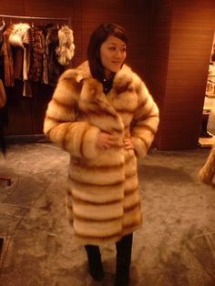 My girl in Aspen. Trying on several furs.