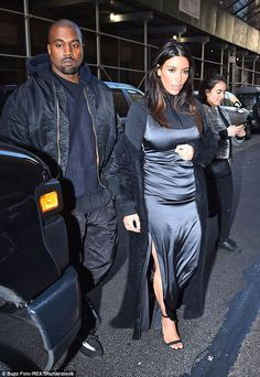 Back to the beat: Kanye West rejoined his glamorous wife Kim Kardashian in NYC on Saturday...