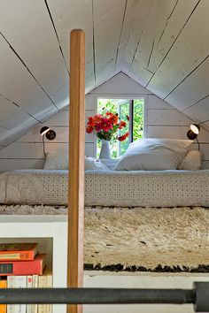 Attic bedroom with fresh flowers( I want to add this to my house so bad )