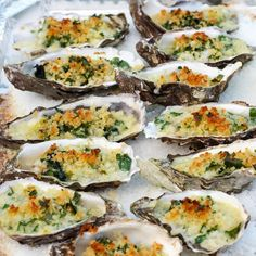 Oysters Rockefeller Recipe Appetizers with butter, garlic cloves, bread crumbs, shallots, fresh spinach, pernod, salt, pepper, olive oil, grated Gruyère cheese, chopped parsley, shells, oysters, rock salt, hot sauce, lemon wedge
