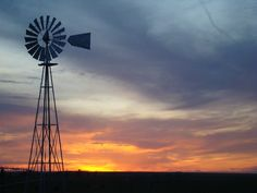 #10 A Kansas sunset. Bold red, orange, purple and blue hues paint the Kansas sky at sunset. An iconic windmill on the Western Kansas plains stands in observance of the setting sun.