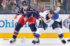 Nick Foligno of the Blue Jackets, Barret Jackman of the Blues