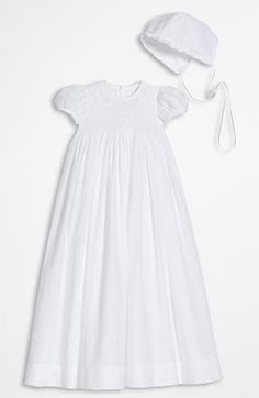 Free shipping and returns on Little Things Mean a Lot Gown (Infant) at Nordstrom.com. Hand-embroidery adds an angelic touch to a smocked-bodice gown crafted from pure cotton and finished with a voluminous skirt.
