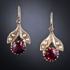 Victorian Garnet and Seed Pearl Earrings. Juicy round faceted garnet fruits are surmounted by a pair of seed pearl-set leaves in these darling antique earrings. 7/8 inch.