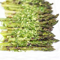 Wake up grilled asparagus with lemon zest, garlic and parsley. Such an easy way to add tons of fresh flavor to basic dishes!