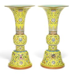 A pair of large famille-rose yellow-ground 'bajixiang' altar vases, gu, Qianlong marks and period (1736-1795)