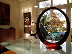 Ariel Geometrica dichroic glass sculpture. Dining room table center piece. Inspired by the star tetrahedron. www.zakayglasscreations.com