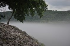 Bull Shoals White River Dam water release causes haze on cold water.