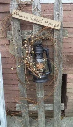 Primitive fence with lantern by tonya