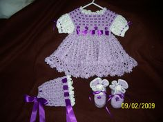 crocheted baby outfit includes bonnet, booties,dress and baby afghan to match.