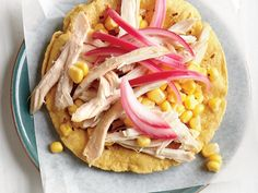 Chicken and Corn Two Ways Tostada | Keep your waistline trim and your taste buds happy with these 20 low-fat chicken recipes that are all less than 200 calories per serving.