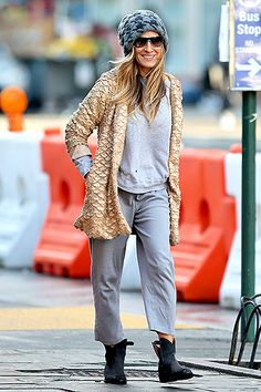 Sarah Jessica Parker added some glam — of course! — to her casual outfit as she walked home in NYC's West Village March 11.