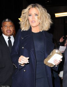 Sparkle: The reality star carried a glittering gold clutch as she left the Trump SoHo Hotel