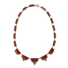 Art Deco Sterling Necklace  possibly German  c. 1930s  Typical of the art deco era, this necklace has a simple, geometric design influenced by the traditional motifs of the Mayan culture. The links are set with marcasites and polished carnelian.