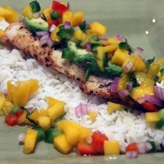Marinated tilapia fillets are grilled and served under a fresh-made mango salsa in this terrific recipe for outdoor cooking. Fish Recipes, Seafood Recipes, New Recipes, Cooking Recipes, Favorite Recipes, Healthy Recipes, Quick Recipes, Lemon Tilapia, Grilled Tilapia