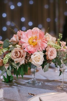 elegant lush low table arrangement of coral charm peonies ivory quicksand roses rust cappuccino
