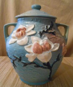 Roseville-Magnolia-Blue-Cookie-Jar-with-white-flowers-2-82-from-1940