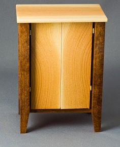 Pete Tucker, Roomboxes, Etc., IGMA fellow - modern music/media center, douglas fir doors. The legs are stained dogwood.