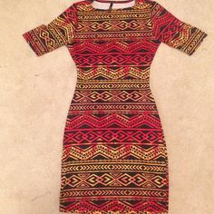 Aztec print bodycon dress It's a red, black with yellow/gold undertone bodycon dress; with a small open back. This dress has only been worn twice, runs slightly on the smaller side. Addictive Styles Dresses