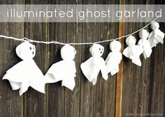 Illuminated Ghost Garland using lantern lights and fabric! So easy! designdininganddiapers.com