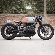 What's not to love about this BMW R100 custom from Madrid's @caferacerdreams? Low, clean, and just the right amount of soft details. #crd76 is another bike in the win column. #dropmoto #builtnotbought #bmw #boxer #r100 #caferacer #caferacerporn #vintagemotorcycle