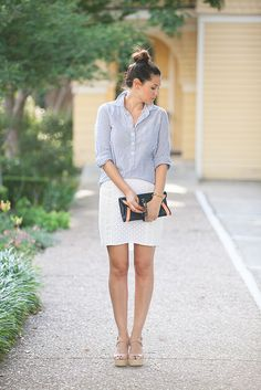the combination of a collared shirt, tighter skirt, nude heels and a bun to top it off