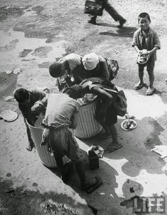 War orphans looking through garbage cans for food, Tokyo, Japan in 1946