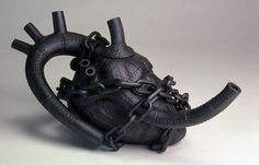 Steampunk heart tea pot...this is really cool....such a nerd...
