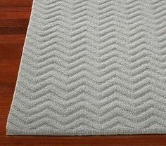 Mini Chevron Rug in grey, this could be an alternate choice for the tv area