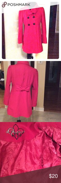 Guess Wool Coat sz M Nice coat, lined with a bow detail on back. It does have a tear on the inside lining where a seam is. Outside looks good. No stains or tears on outside of coat. Nice bright pink color with black buttons. Guess Jackets & Coats