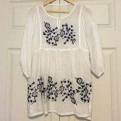 Embroidered Top No size tag but fits like an XS.  Excellent condition.  Embroidery is navy blue. Tops Blouses