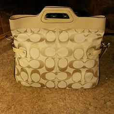 Coach Purse Beautiful tan colored authentic coach purse with red lining. In great gently used condition. Make me an offer:) Coach Bags