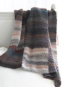 """Tinted Squares Afghan...never done one of these afghans that you work in """"strips"""" then sew together..but, again, looks like a fast project...I like the idea of using a larger hook for a lighter, airier blanket."""