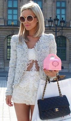 Not so sure about the mail order bride lace underneath but love the Chanel jkt with the shorts