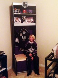 Except DIY Hockey Stall   Cool hockey room! Sport Locker can be bought at Sport Interiors! (www.sportinteriors.com) for $699.  Team stickers on top and on the side of display, jersey, accessories and kid is not included :) The Sport Lockers can be customized in all colors and you can decorate it yourself with you own favorite team stickers and accessories!