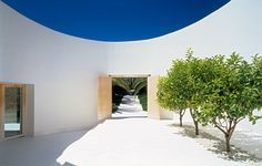 Interior courtyard inside the House Sardegna. Architect: Merkle. Photography by Jens Wber. Nice minimal use of materials.
