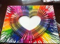heart crayon melts. Looks so hard and artsy but it is as easy as 123. Put crayola crayons into shape of heart and glue them onto a canvas. Then blow dry the tips of crayons and wax should melt