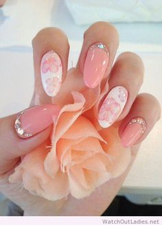 Pink and white stiletto flower nails with rhinestone