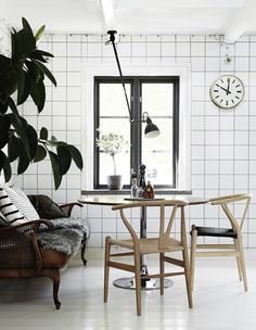 wood, black, tiles, angle poise light, bold greenery, wall clock