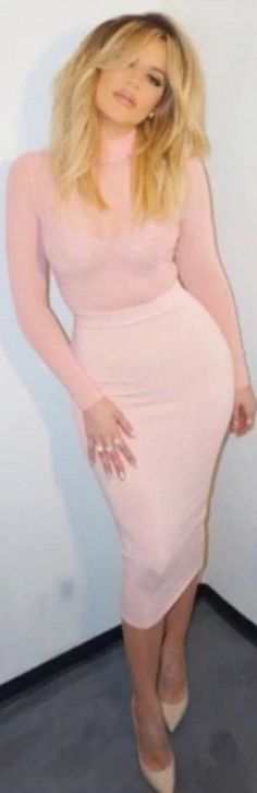 Who made  Khloe Kardashian's nude pumps, pink skirt, and long sleeve top?