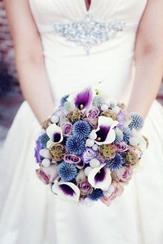 Unique purple wedding bouquet...love her middle bodice piece